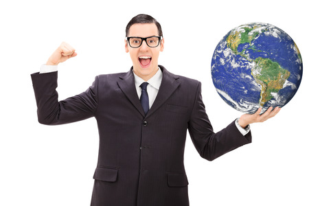 Successful businessman holding the world in his own hand isolated on white background photo