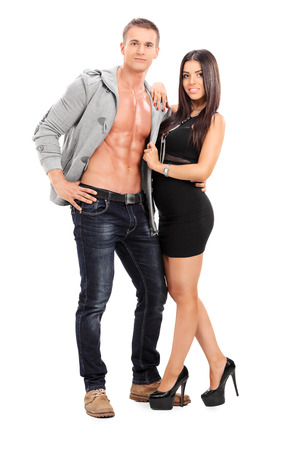 Attractive couple posing together isolated on white background photo