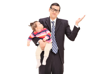 irrelevant: Carefree businessman holding his daughter and gesturing with his hand isolated on white background