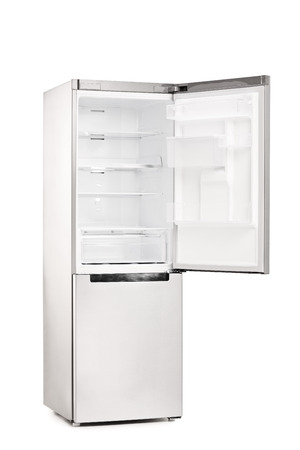 Studio shot of an empty refrigerator with opened door isolated on white background photo