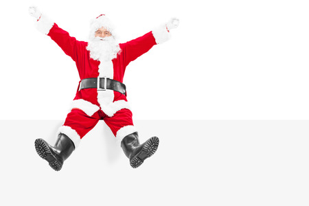 delighted: Delighted Santa Claus sitting on a blank panel isolated on white background Stock Photo