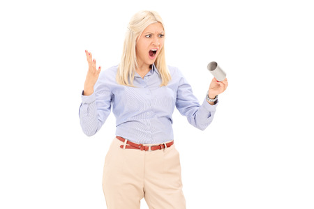 Angry woman holding an empty toilet paper roll isolated on white background photo