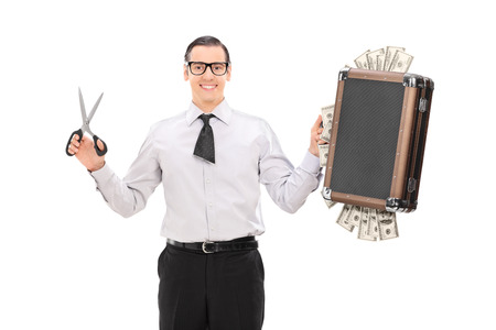 Young businessman with cut tie holding bag full of money isolated on white background photo