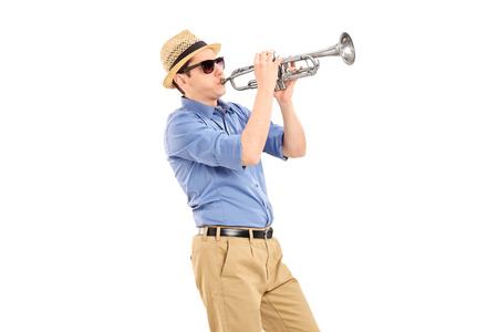 trumpeter: Young musician playing a trumpet isolated on white background