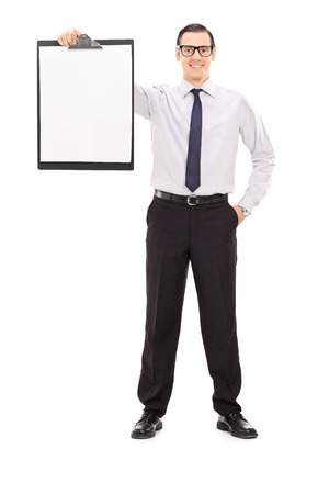 Full length portrait of a young businessman holding a clipboard isolated on white background photo