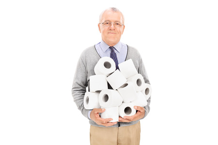 Senior carrying a pile of toilet paper isolated on white background photo