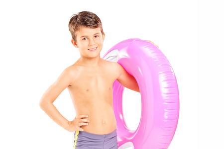 boy swim: Cute little boy holding a swim ring isolated on white background
