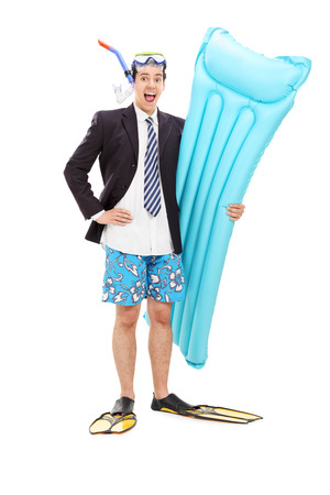 Full length portrait of a joyful businessman with diving equipment posing isolated on white background photo