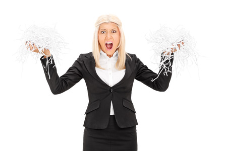 outraged: Outraged businesswoman holding a shredded document isolated on white background Stock Photo