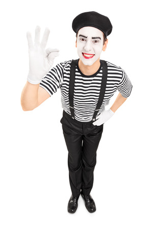Mime artist gesturing with his hand isolated on white background
