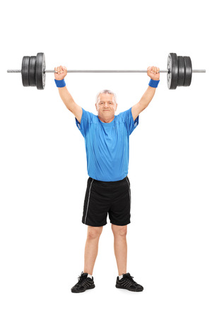 heavy weight: Full length portrait of a mature man in sportswear holding a heavy weight isolated on white background