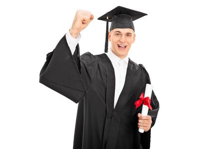 Happy guy celebrating his graduation isolated on white background