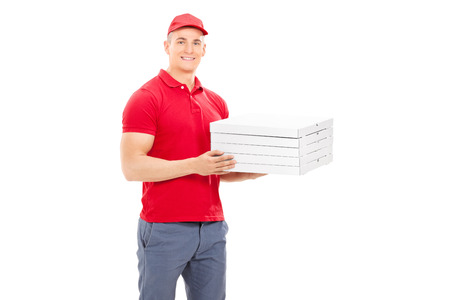 order delivery: Delivery guy carrying five pizza boxes isolated on white background
