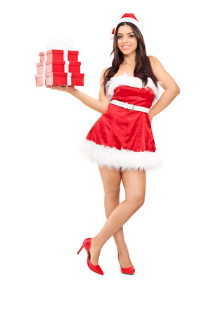 Full length portrait of a beautiful woman in Santa costume holding presents isolated on white background photo