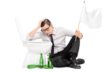 single person: Drunk man sitting by a toilet and holding white flag isolated on white background