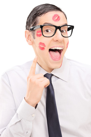 lipstick kiss mark: Happy guy showing the lipstick kiss marks on his face isolated on white background Stock Photo
