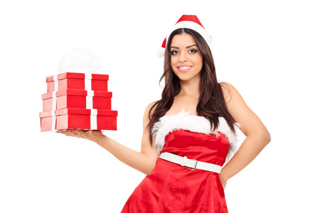 Beautiful woman in Santa costume holding presents isolated on white background photo