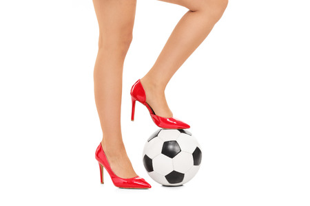 Girl with football under her foot isolated on white background photo