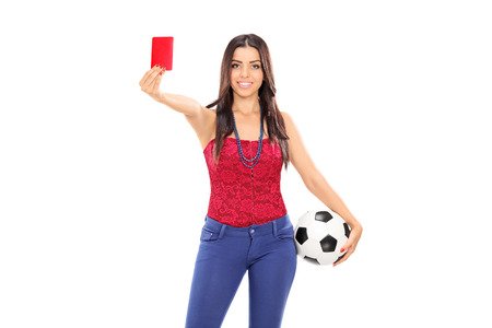 Female football fan showing a red card isolated on white background photo