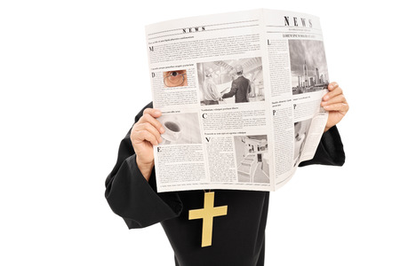 catholic priest: Sneaky priest peeking through a hole in newspaper isolated on white background