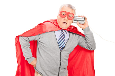 tin can phone: Shocked senior superhero with a tin can phone isolated on white background Stock Photo