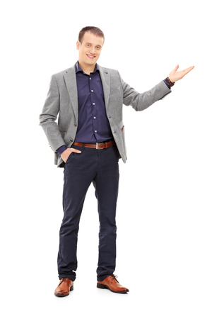 Full length portrait of an elegant man gesturing with his hand isolated on white background