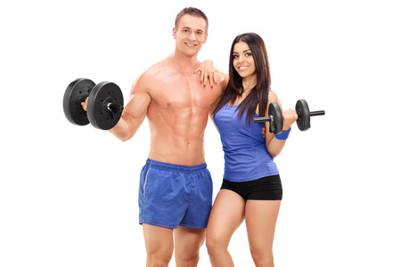 Couple of athletes posing with metal weights isolated on white background photo