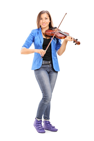 woman violin: Full length portrait of a young female artist playing a violin isolated on white background