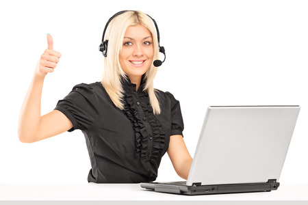 posing  agree: Female call service operator giving a thumb up isolated on white background Stock Photo