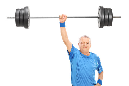 1 mature man: Strong senior holding a weight in one hand isolated on white background