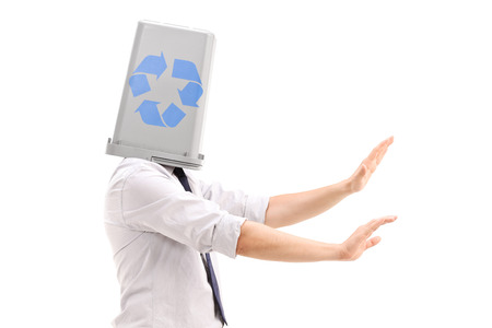roving: Lost man with a recycle bin over his head isolated against white background Stock Photo