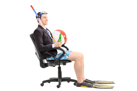 beach wear: Businessman with snorkel sitting in an office chair isolated on white background