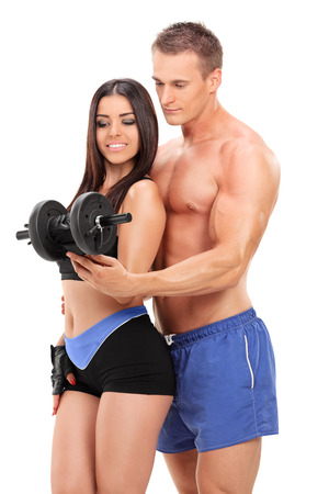fitness couple: Attractive couple exercising with a weight isolated on white background