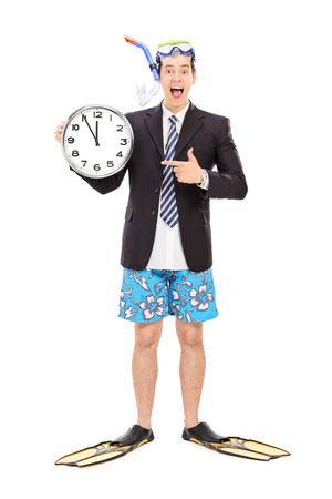 single fin: Full length portrait of a joyful businessman with a snorkel holding a big wall clock isolated on white background Stock Photo