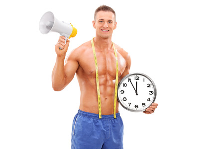 Shirtless man holding a clock and a megaphone isolated on white background photo