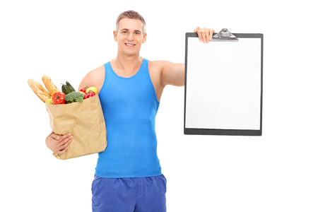 clipboard isolated: Young athlete holding a grocery bag and a clipboard isolated on white background