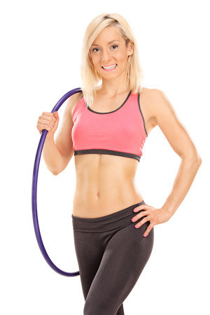 Blond female athlete holding a hoop isolated on white background photo