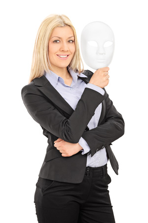 theatre masks: Vertical shot of a businesswoman holding a theater mask isolated on white background
