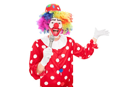 clown birthday: Male clown speaking on a microphone isolated on white background