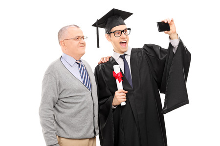 College graduate taking a selfie with his father isolated on white background