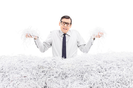 powerless: Powerless employee holding bunch of shredded paper isolated on white background
