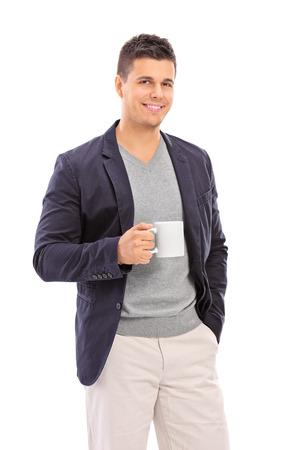 mug shot: Elegant man holding a coffee mug isolated on white background Stock Photo