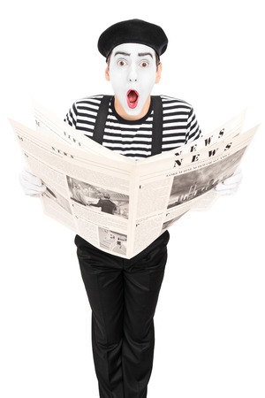comedic: Street artist with newspaper making a grimace isolated on white background