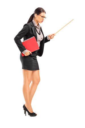 sexy teacher: Full length portrait of an angry female teacher swinging with a stick isolated on white background Stock Photo