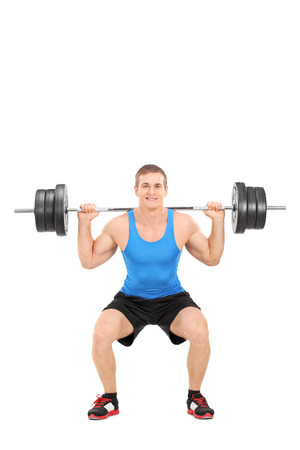 weightlifter: Full length portrait of a strong man exercising with a barbell isolated on white background Stock Photo