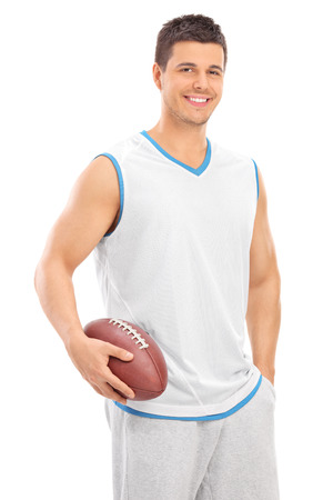 rugby: Young male football player holding a ball isolated on white background Stock Photo