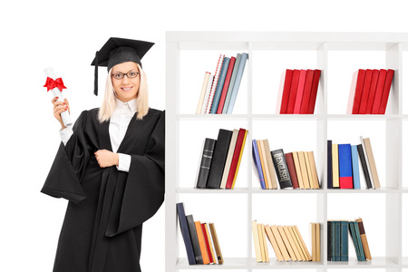 single shelf: Female graduate leaning on a bookshelf isolated on white background
