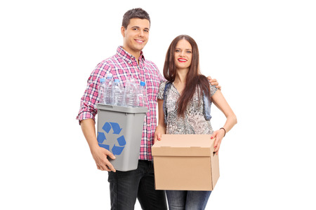 recycling bin: Couple holding a box and a recycle bin isolated on white background Stock Photo