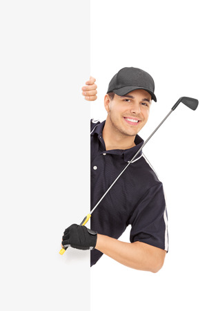 golfer: Male golfer posing behind a blank panel isolated on white background