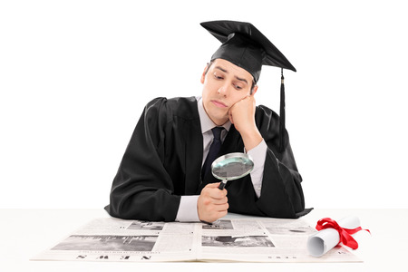Graduate student searching for job in the papers isolated on white background